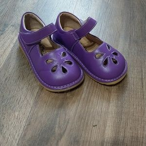Purple Mary Jane shoes.